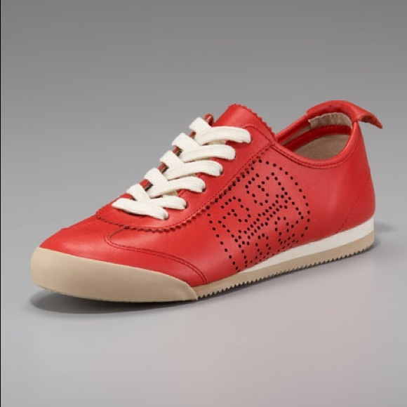 da69c149d891da Tory Burch Perforated Leather Murphey Sneakers. M 5a356a4f05f4308925015275